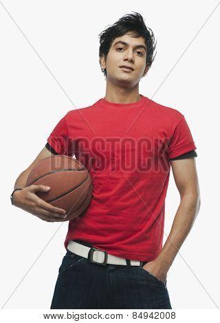 Portrait of a man holding a basket ball