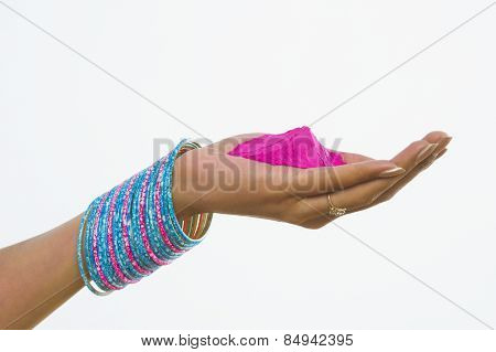 Close-up of a woman's hand holding Holi colors
