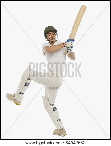 Cricket batsman playing a hook shot