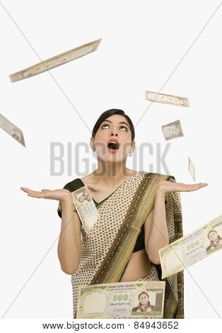 Money falling over a woman