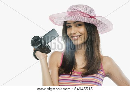 Portrait of a woman filming with a home video camera