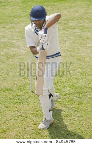 Batsman in backward defense stance