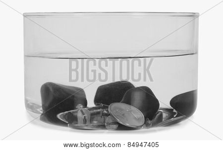 Close-up of stones sunk in a bowl of water