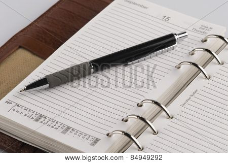 Close-up of a pen on a personal organizer