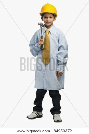 Boy dressed as an architect and holding a hammer