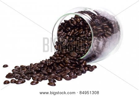 Coffee beans spilling out from a jar