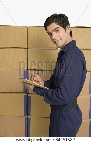 Store incharge checking inventory