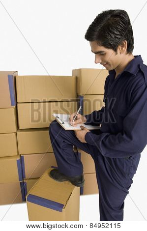 Store incharge counting cardboard boxes