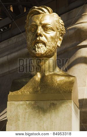 Bust of Gustave Eiffel near a tower, Eiffel Tower, Paris, France