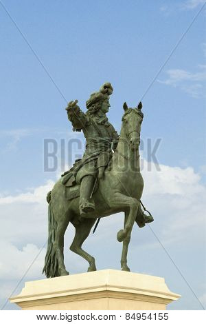 Low angle view of statue of Louis XIV, Chateau de Versailles, Versailles, Paris, France