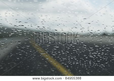 Rain drops on the windshield of a car