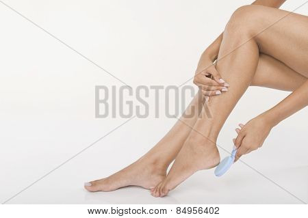 Woman exfoliating her feet