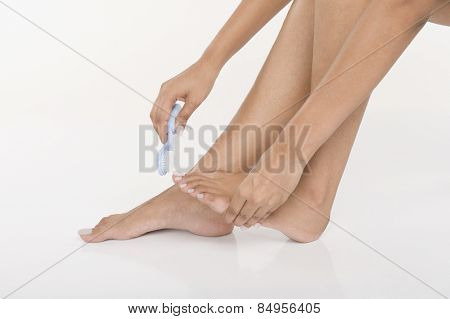 Woman brushing her toenails