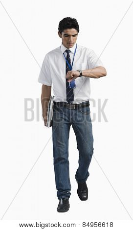 Office worker looking at wristwatch