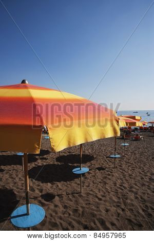Beach umbrellas on the beach, Amalfi, Province Of Salerno, Gulf Of Salerno, Tyrrhenian Sea, Campania, Italy0