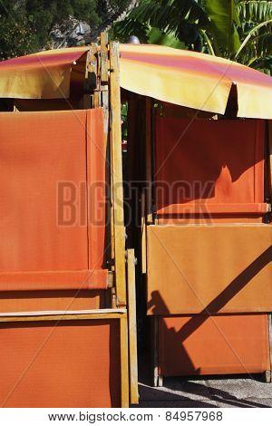 Beach umbrella and folded reclining chairs, Amalfi, Province Of Salerno, Gulf Of Salerno, Tyrrhenian Sea, Campania, Italy