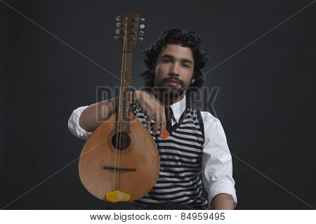 Musician holding a lute