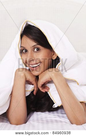 Woman covering herself with a bedsheet