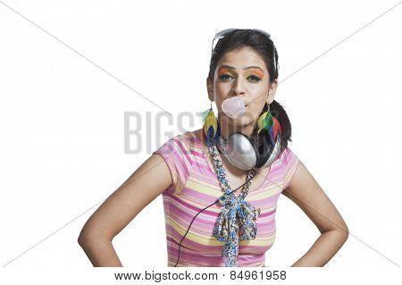 Beautiful young woman blowing bubble gum