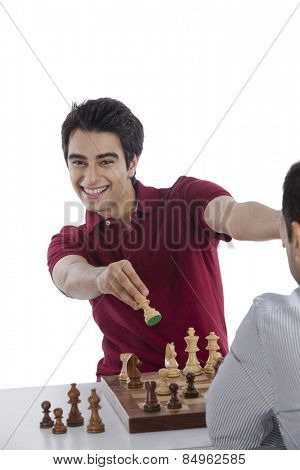 Man celebrating his success after winning chess game