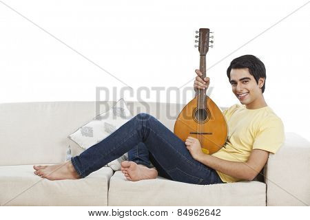 Portrait of a man playing a mandolin