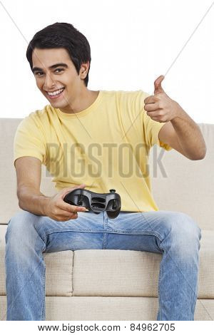 Man showing thumbs up sign while playing a video game