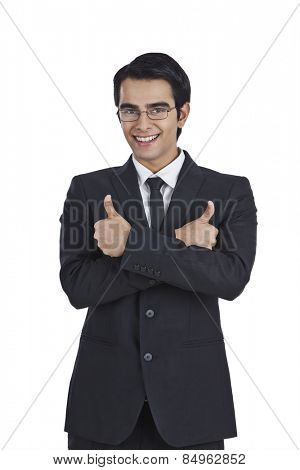 Portrait of a businessman showing thumbs up