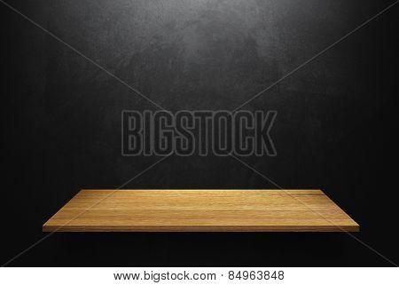 Empty wood shelf on loft style wall texture