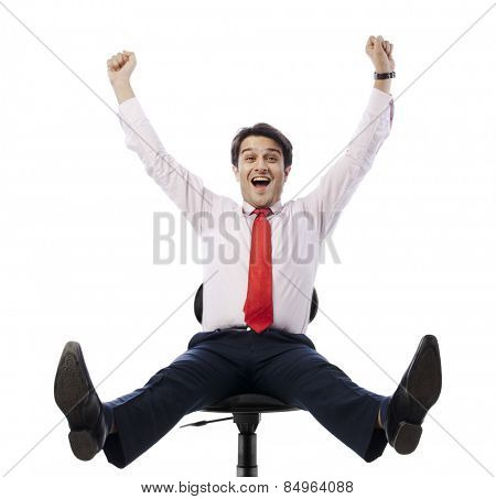 Businessman sitting on an office chair and looking excited