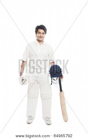 Batsman holding a cricket bat with sports helmet and smiling
