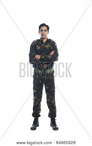 Portrait of an army soldier standing with his arms crossed
