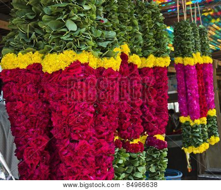 Garlands for sale hanging at a market stall, Chennai, Tamil Nadu, India