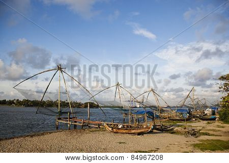 Chinese fishing nets and boats on the beach, Cochin, Kerala, India