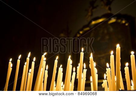 Burning votive candles