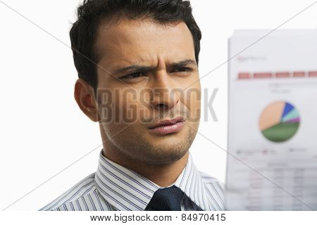 Businessman looking at a financial newspaper