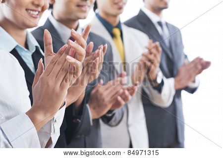Business executives applauding