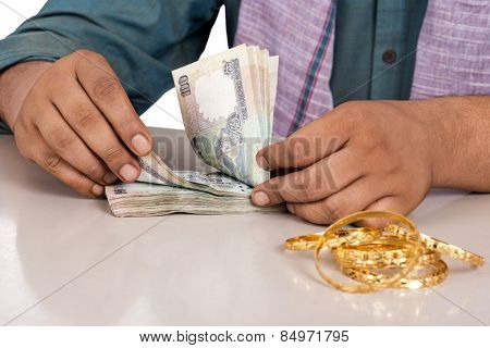 Mid section view of a man counting money
