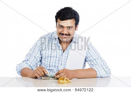 Portrait of a South Indian man counting money
