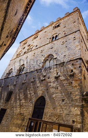 Low angle view of a historical building in a old town, Volterra, Province of Pisa, Tuscany, Italy