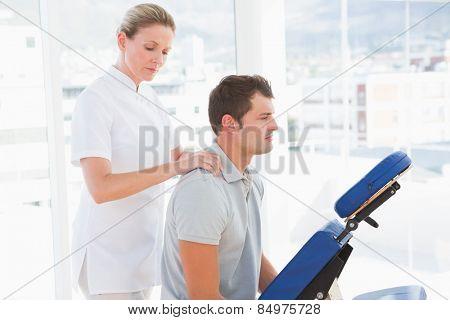 Man having shoulder massage in medical center