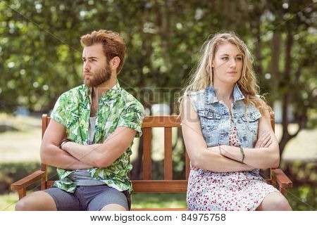 Young couple not talking after argument on a summers day