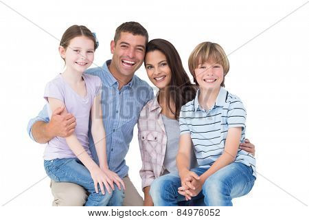 Portrait of happy children sitting on parents laps over white background