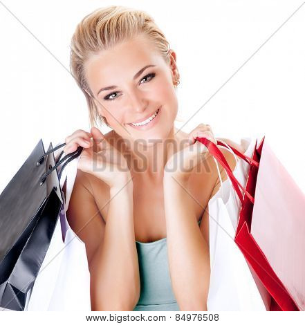 Portrait of cute happy girl with shopping bags isolated on white background, enjoying seasons sales, spending money with pleasure