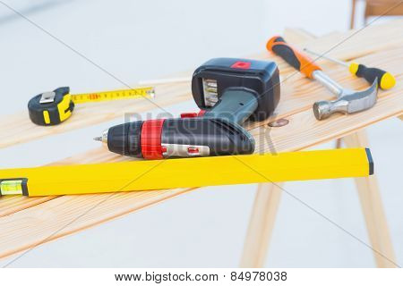 Construction tools on workbench at site