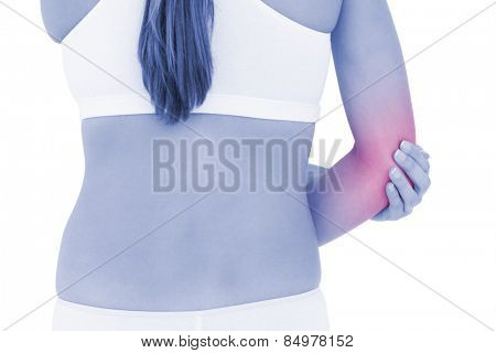 Rear view mid section of a fit young woman with elbow pain over white background
