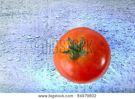 Red Tomato over blue Water drops background