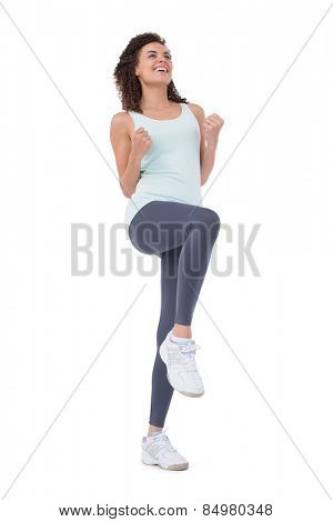 Fit woman doing aerobic exercise on white background