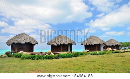 Four bungalows In Front Of Turquoise Sea.