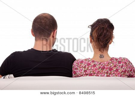 Couple From Back, On Couch, Isolated On White. Studio Shot