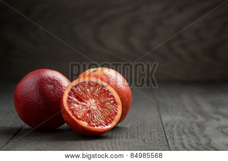 ripe red oranges on wooden table